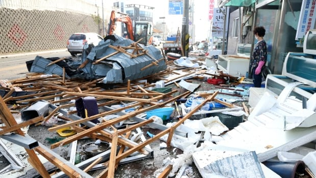 At least 1 person killed as Typhoon Maysak lashes waterlogged Koreas