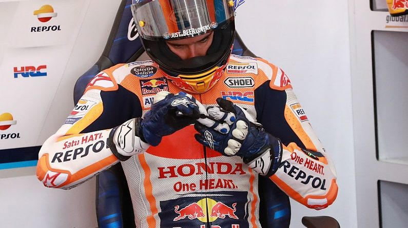 Marquez escapes with hand injury after violent Valencia MotoGP crash - MotoGP