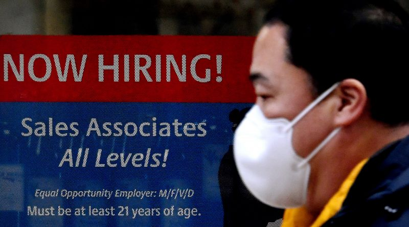 Jobless claims hit pandemic-era low even as Covid surges