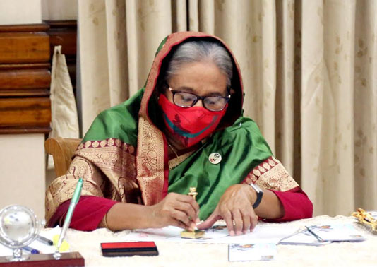 PM releases postage stamps | Bangladesh Sangbad Sangstha (BSS)